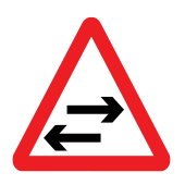 Two-way traffic crosses one-way road